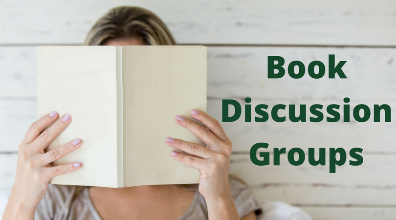 Woman holding book with text Book Discussion Groups